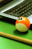 Snooker ball and laptop — Photo