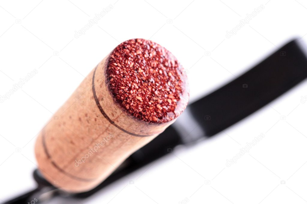 Red wine cork on an opener, isolated — Stock Photo #2411275