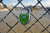 Green Lock is closed on to a fence — Stock Photo