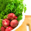 Foto Stock: Radish and greenery