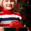 Boy with gifts — Stock Photo