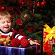 Stock Photo: Boy with gifts