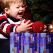 Child with gifts — Stock Photo #2099262