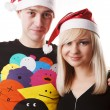 Couple in christmas hats — Stock Photo #2431892