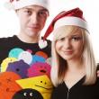Couple in christmas hats — Stock Photo