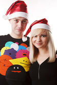 Couple in christmas hats — Stock Photo