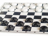 Checkers on board — Stock Photo