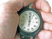 Retro un cronómetro en una mano — Foto de Stock