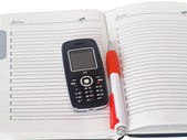Organizer, mobile phone and pen — Stock Photo