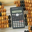 Abacus and the calculator — Stock Photo