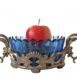 Bronze support, vase and an apple — Stock Photo #2639884