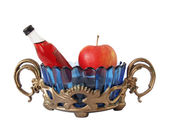 Support, vase, bottle and an apple — Stock Photo