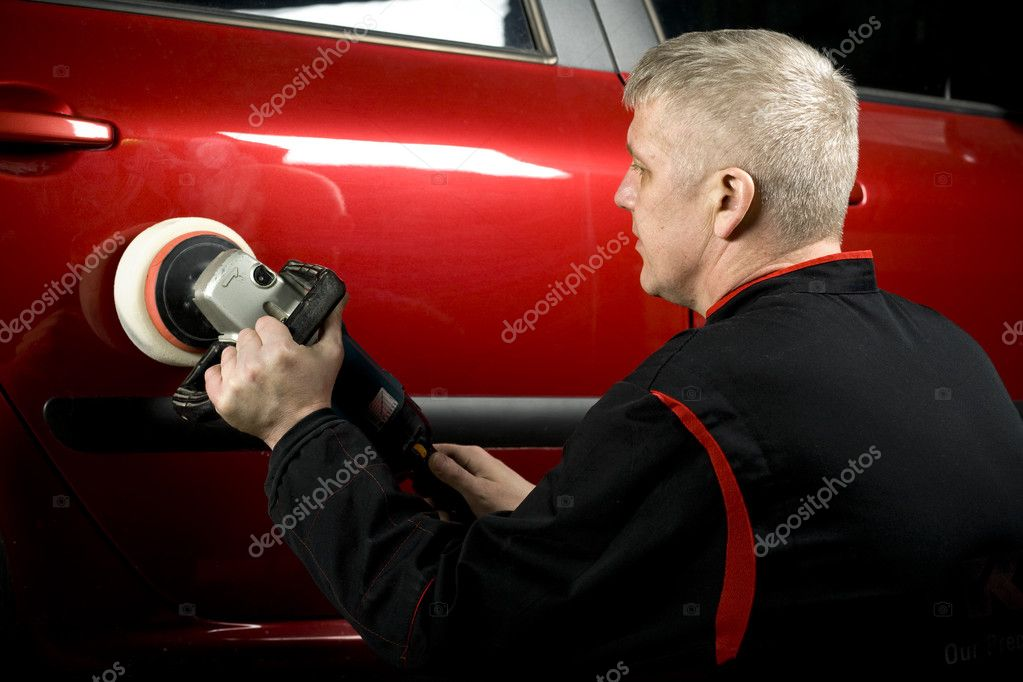 Waxing by polishing machine of the lateral part of red car — Stock Photo #2587755