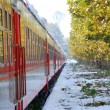 Red train on platform in winter — Stockfoto #2074832