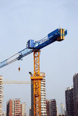 Tower crane in building site — Stock Photo