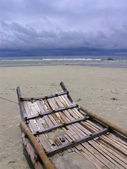 Bamboo raft on beach — Stock Photo