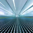 Movement on an airport escalator - Stock Photo