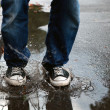 Jump in the puddle — Stock Photo