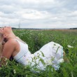 Stock Photo: Young woman on a meadow