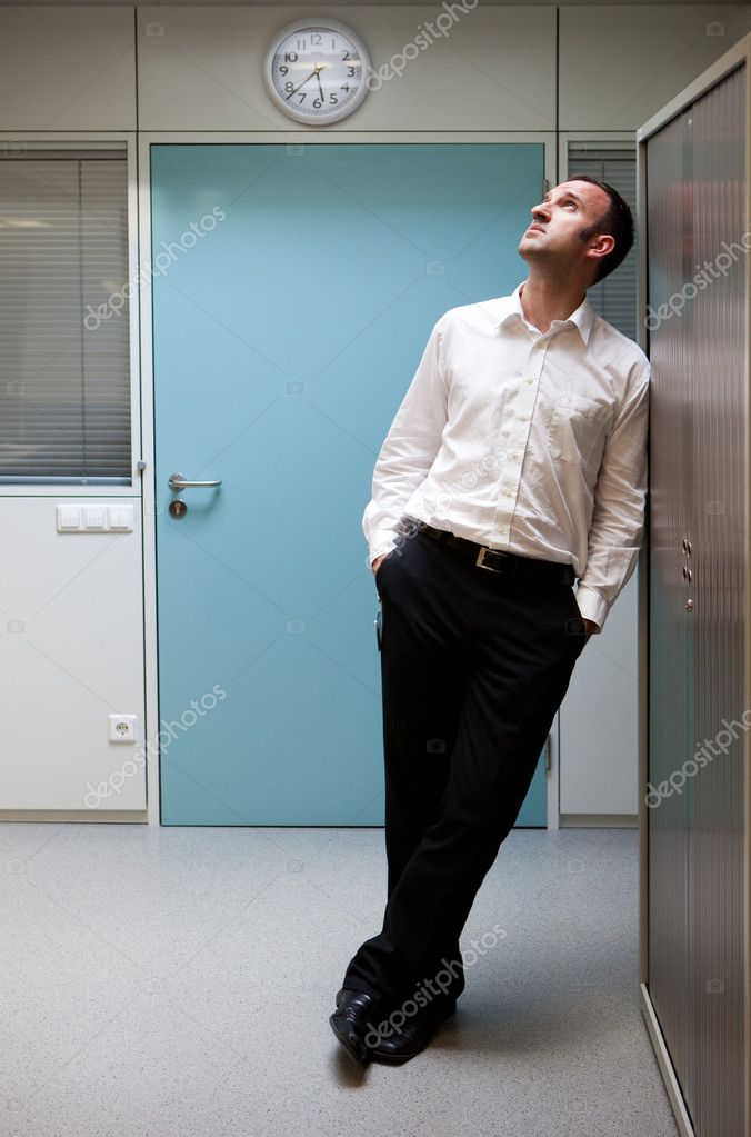Business man is thinking in front of a clock — Stock Photo #2102341