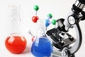 Microscope, flasks — Stock Photo