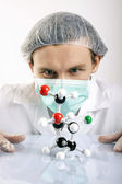 Scientist and molecules — Stock Photo