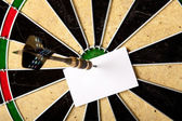 Bullseye and peace of paper — Stock Photo