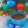 Stock Photo: Christmas tree and tecup