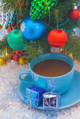 Christmas tree and tea cup — Stock Photo