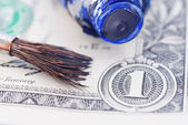 Brush, oilpaint and dollar — Stock Photo
