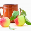 Cup and apple — Stock Photo