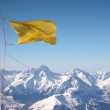 Foto Stock: Yellow flapping flag
