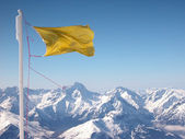 Yellow flapping flag — Stock Photo
