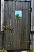 Wooden door with a mirror and a lock — Stock Photo