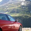 Постер, плакат: Alfa Romeo in swiss mountains