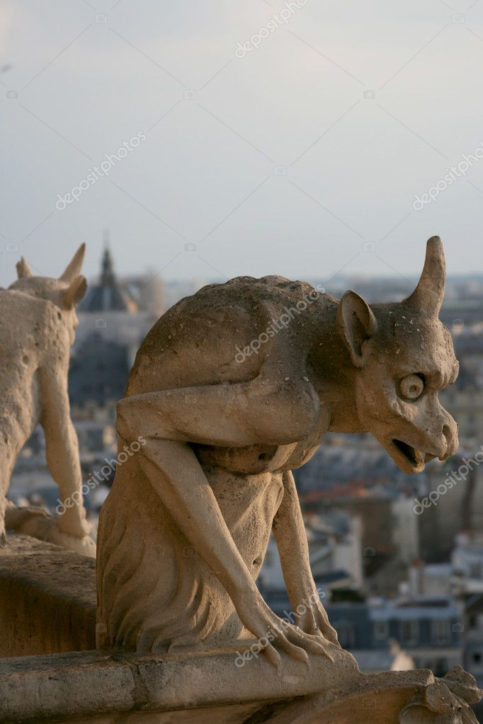 Chimera in gothic style is watching over Paris from top of Notre Dame cathedral.  Stock Photo #2579308