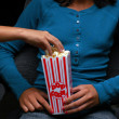 Teen at movies with popcorn — Stock Photo