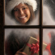 Girl in Window with Christmas Present — Stock Photo