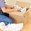 Woman Unpacking Moving Box — Stock Photo #2079764