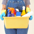 Woman in Overalls with Cleaning Supplies — Stockfoto