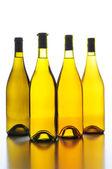 Four Wine Bottles Back Lit — Stock Photo
