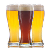 Glass of Dark Ale and Two Pale Ales — Stock Photo