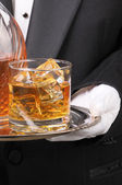 Butler holding Cocktail on tray — Stock Photo