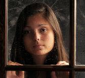 Girl in Window with Rain Drops — Stock Photo