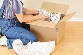 Woman Unpacking Moving Box — Stock Photo