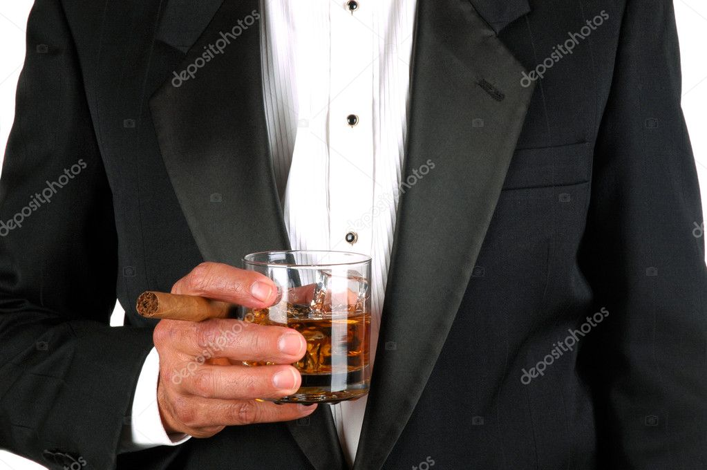 Man in Tuxedo holding a Cigar and a Glass of Whiskey - close — Stock Photo #2078312