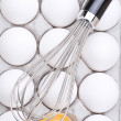 Whisk on Eggs — Stock Photo
