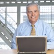 Businessman with Laptop Computer - Stock Photo