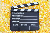 Movie Clapboard on Popcorn — Stock Photo