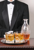 Waiter with mixed drinks on tray — Stock Photo
